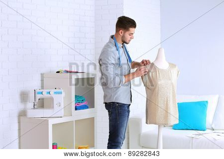 Young man fashion designer in studio