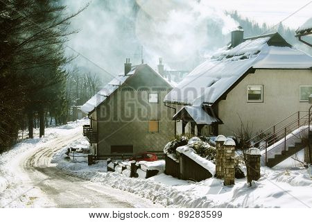Houses and street under the snow