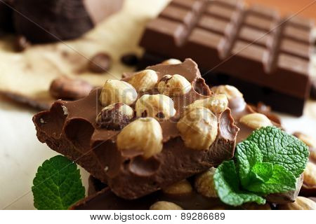 Chocolate with nuts, spices and mint, closeup