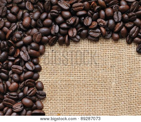 Canvas and coffee beans  photo background.Coffee themes