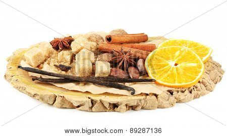 Christmas spices and baking ingredients on wooden board, isolated on white background
