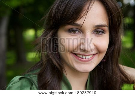 Portrait of cute young woman smiling