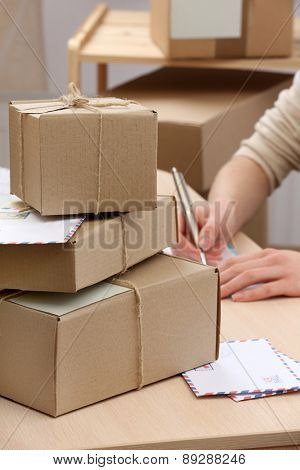 Cardboard boxes on work place in post office