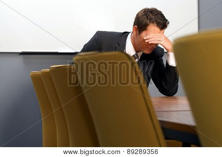 Despaired businessman sitting in office