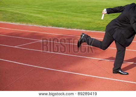 Businessman running on race track