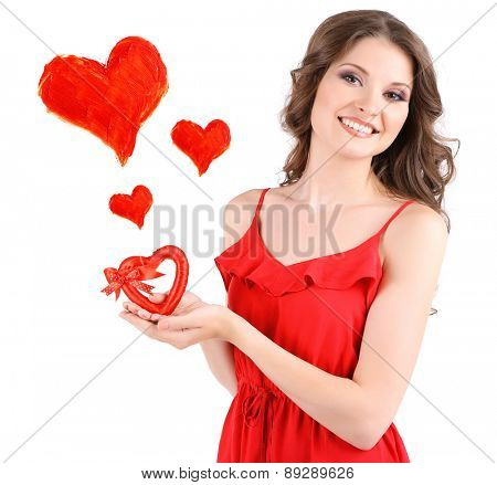 Beautiful young girl with hearts isolated on white