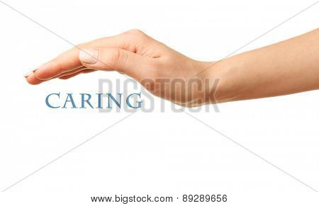 Female hand with word caring isolated on white