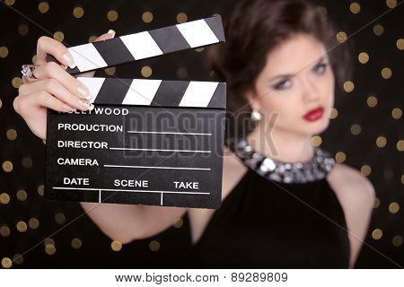 Beautiful Brunette Woman Model Holding Film Clap Board Cinema. Fashion Portrait Of Girl With Makeup,