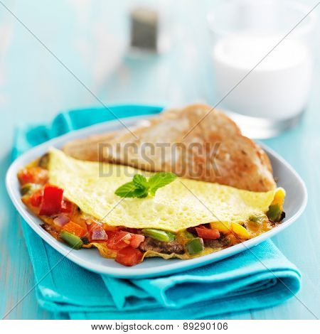 breakfast omelette with vegetables and cheese