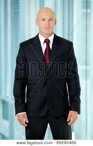 Portrait of young caucasian businessman in office