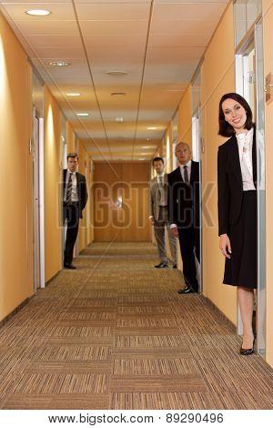 Business people standing in corridor