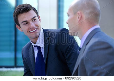 Businessmen in conversation looking at each other