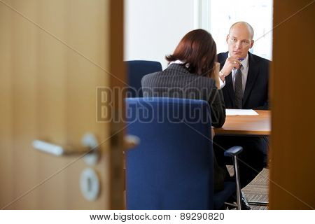 Businessman in discussion with businesswoman