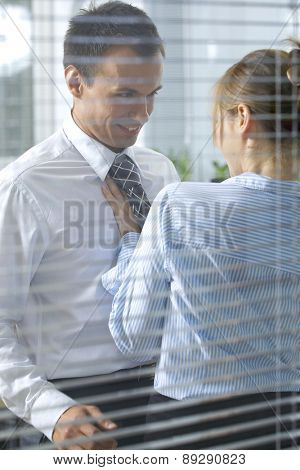 Businesswoman flirting with his colleague in office