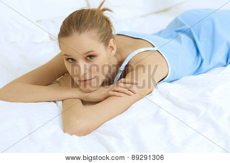 Woman Relaxing on bed