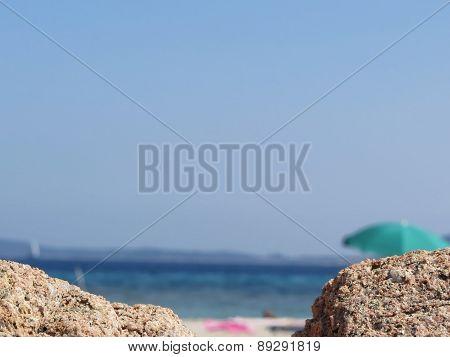 Rocks Of Tavolara Island On Blurred Background