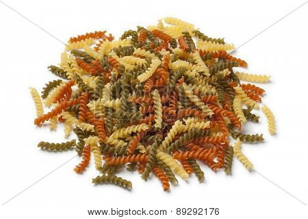 Heap of traditional Italian fusilli tricocolore on white background