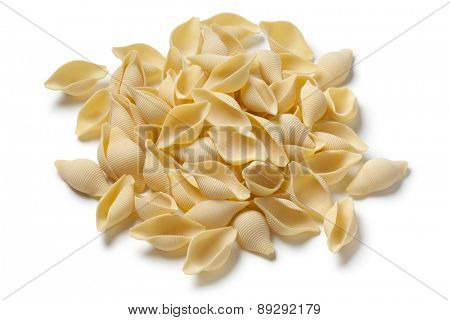 Heap of traditional Italian conchiglie on white background