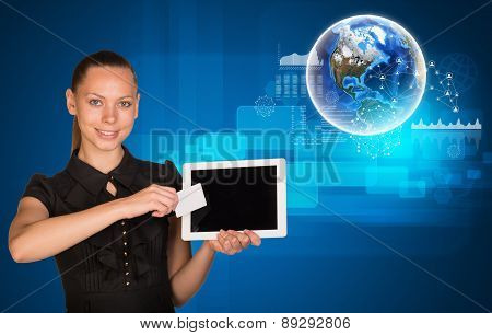 Smiling woman holging tablet and card