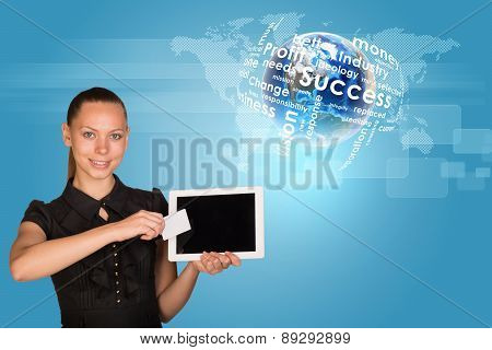 Businesswoman holging tablet and card