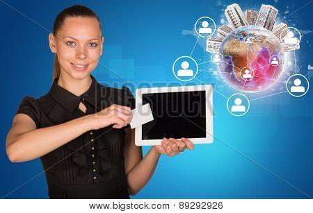 Businesswoman holging tablet and blank card