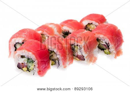 Tuna, cucumber, tomato, avocado, masago orange and cream cheese rolls isolated on white background