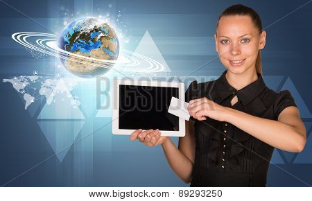 Businesswoman with glowing Earth model