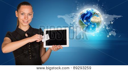 Businesswoman in black dress with Earth model
