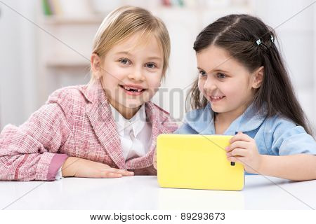Two little cute girls playing role of business women