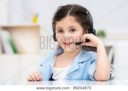 Little dark-haired girl playing role of business woman