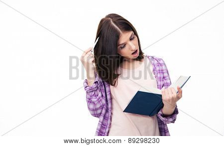 Surprised woman reading book over white background
