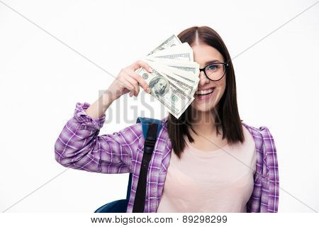 Happy woman covering her eyes with bills of dollar over white background and looking at camera