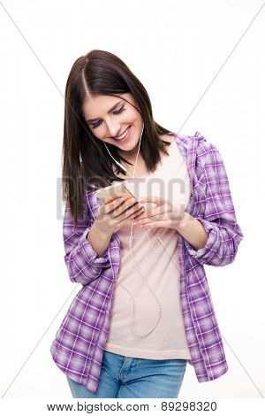 Smiling woman using smartphone over white background