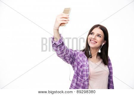 Happy woman making selfie photo on smartphone over white background