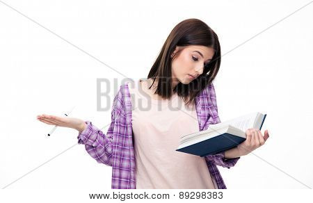 Young female student reading book over white background