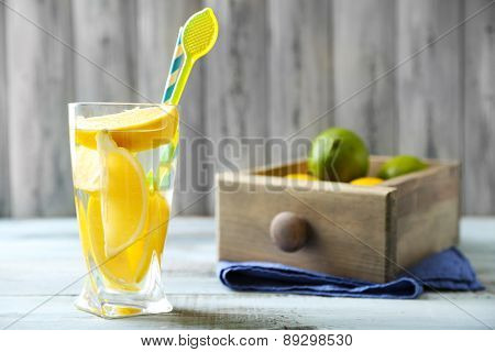 Cocktail with fresh citrus fruits on wooden background
