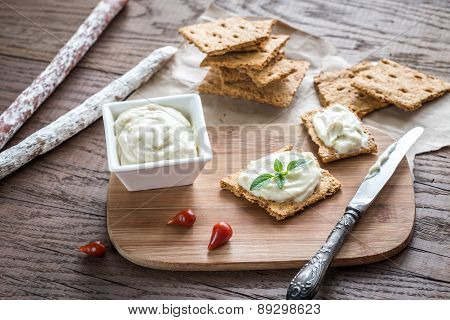 Crisps With Cream Cheese On The Wooden Board