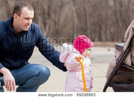 Happy Father Walking With Pretty Beautiful Little Girl