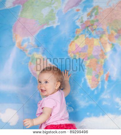 Happy Baby Girl Studying Map Of World