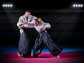 stock photo of aikido  - Two aikido fighters at sports hall - JPG