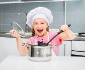 pic of chef cap  - little girl in a cap chef prepares soup - JPG