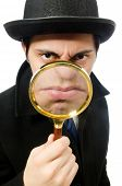 stock photo of sherlock holmes  - Sherlock Holmes with magnifying glass isolated on white - JPG