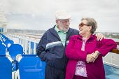 pic of passenger ship  - Happy Senior Couple Enjoying The View From Deck of a Luxury Passenger Cruise Ship - JPG