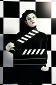 foto of clapper board  - Movie actor and a mime posing with clapper board with different emotions - JPG