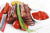 picture of red meat  - roast red beef meat fillet with red hot pepper with ketchup mayonnaise and mustard on plate isolated on white background - JPG