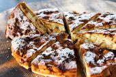 stock photo of sponge-cake  - Authentic sponge cake with raisins cinnamon and apples - JPG