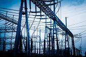 foto of voltage  - High voltage towers with sky background - JPG