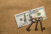 foto of hasp  - US dollar banknotes and old keys on an old cloth - JPG