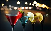 image of foreground  - Different cocktails garnished with fruits focus on foreground - JPG
