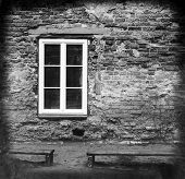 foto of pews  - grunge brick wall with a window and two benches - JPG